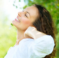 Happy Spring from ENH - beautiful brunette smiling in sunshine