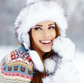 smiling brunette in furry winter hat